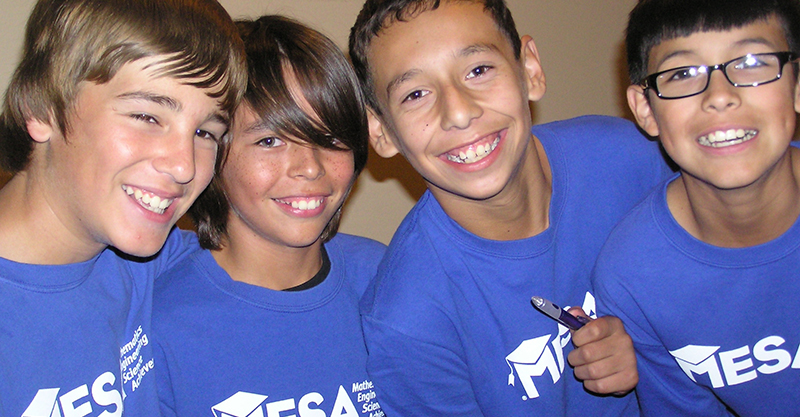 4 young boys in MESA t-shirts