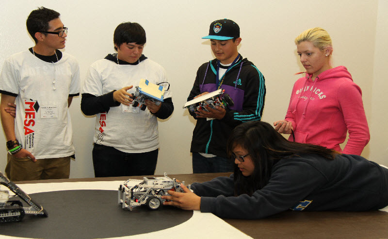 students competing with robots