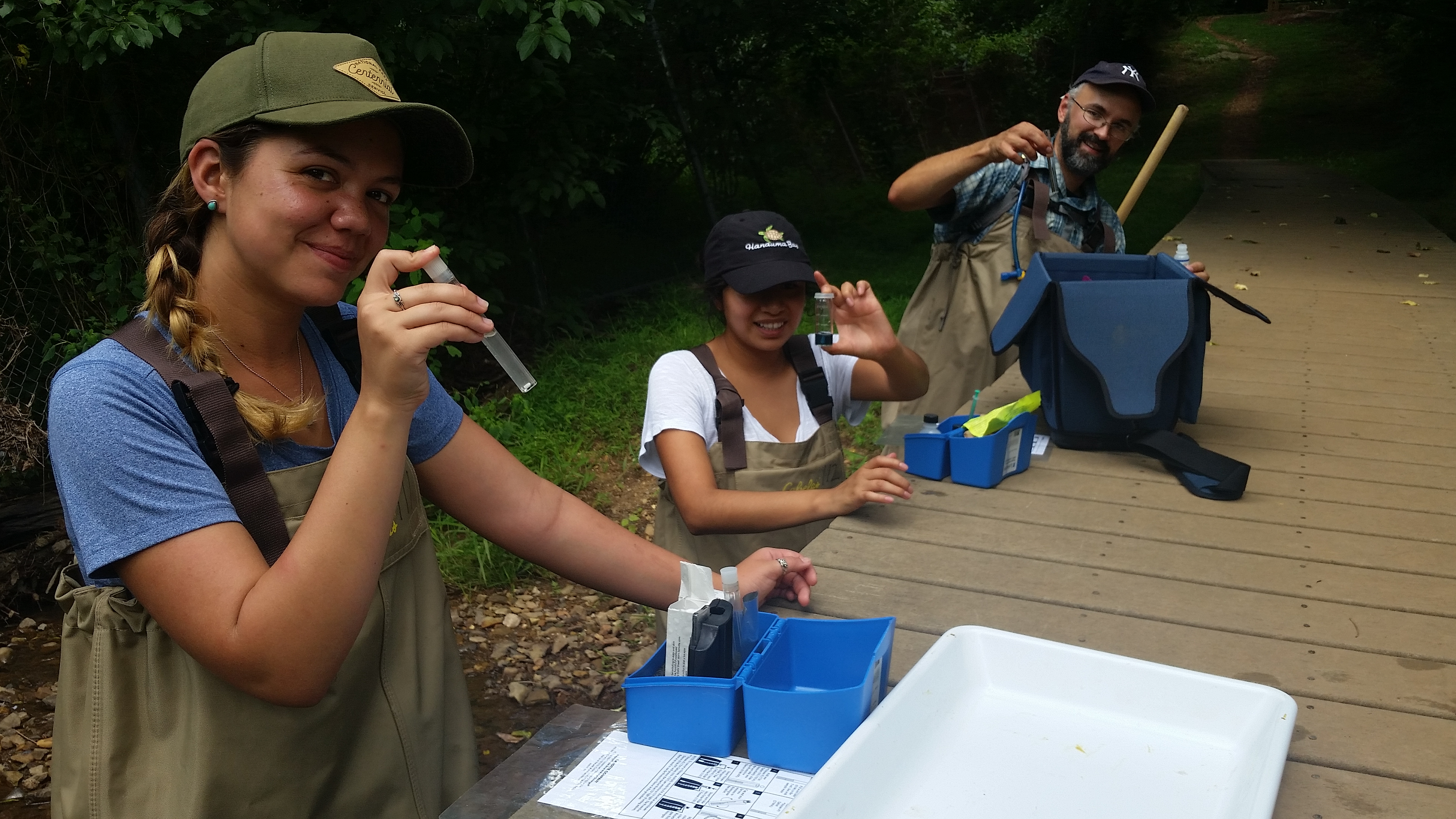 students taking water samples